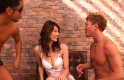 Erika Kirihara is a lovely big boobed Japanese chick gets fucked by two guys