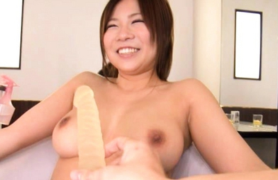 Konatsu Aozora is a horny Japanese doll playing with her big tits