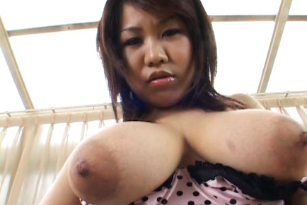 Rika Momoi Lovely Asian doll has big tits exposed